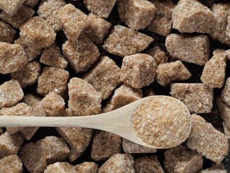 rushy: Rushy raw sugar cubes close up