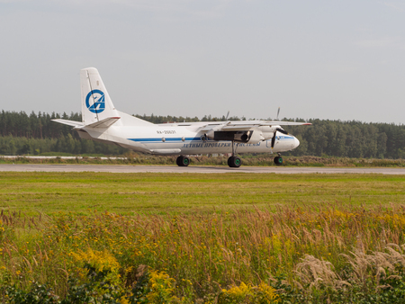 Nizhny Novgorod, Russia - August 23, 2017: An-26 airliner is taking-off on the runway of the airport Strigino.