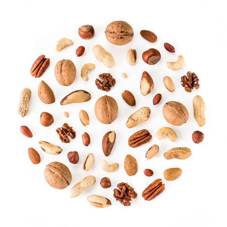 Pattern of nuts in circle form. Various nuts isolated on white. pecan, macadamia, brazil nut, walnut, almonds, hazelnuts, pistachios, cashews, peanuts, pine nuts. Top view or flat-lay. Copy space Imagens