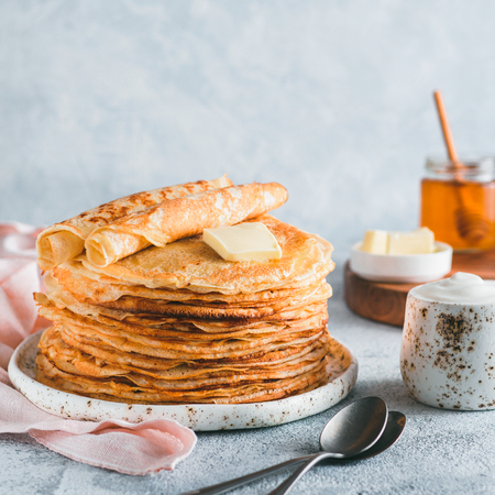 Stack of traditional russian pancakes blini on gray background with copy space. Homemade russian thin pancakes blini. Russian food, russian kitchen Stock fotó