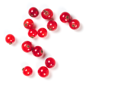 Creative layout of red currant berries. Food and diet concept. Top view of ripe red currant berries with copy space. Isolated on white with clipping path. 스톡 콘텐츠