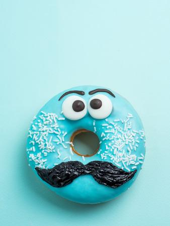 Blue glazed donut with mustache flying 版權商用圖片