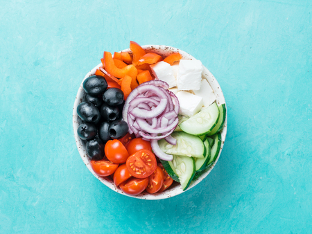 Greek Salad Bowl on blue background, copy space. Above view of Bowl Greek Salad. Trendy food. Idea, recept and concept of modern healthy food. Banner Stock fotó