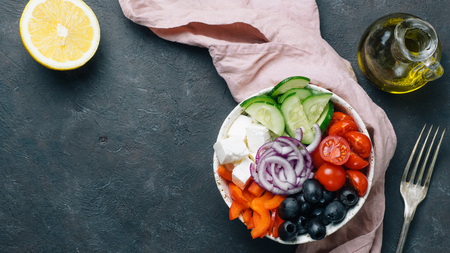 Greek Salad Bowl on dark black background, copy space. Above view of Bowl Greek Salad. Trendy food. Idea, recept and concept of modern healthy food. Banner Stock fotó