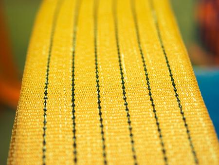 Les élingues de levage souples en nylon jaune se bouchent Banque d'images