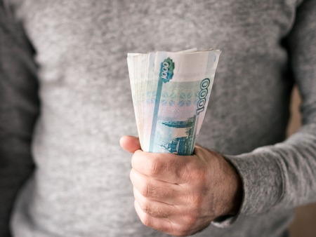 Hands hold russian rubles. Selective focus. Shallow DOF