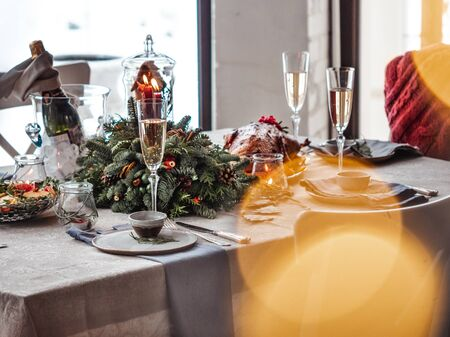 Table setting for Christmas dinner, image with bokeh