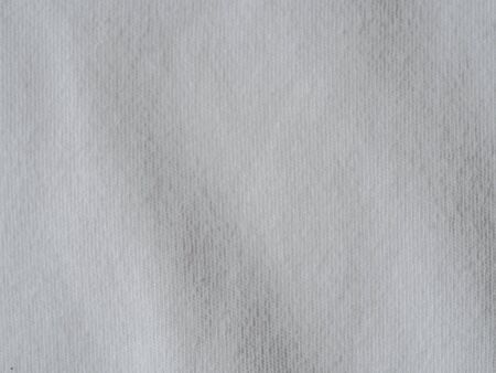 White cotton fabric texture. Clothes cotton jersey background with folds