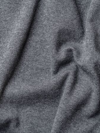 Gray cotton fabric texture. Clothes cotton jersey background with folds Stok Fotoğraf