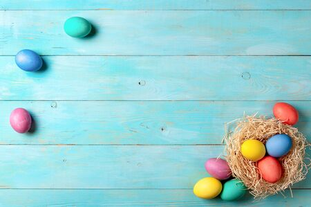 Easter concept. Colorful eggs on blue wooden background with copy space for text. Top down view or flat lay Stok Fotoğraf - 140186872