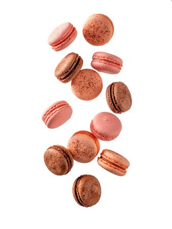 Fly french macarons. Levitate composition with different types colorful macaroons in motion falling or flying isolated on white background