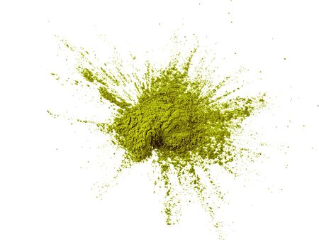 Green matcha tea powder on white background. Powdered maccha tea explosion, isolated on white with clipping path. Top view or flat lay.