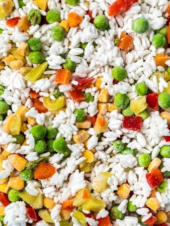 Frozen vegetables assorted, close up view. Assorted frozen vegetables food with ice, top view or flat lay. Raw uncooked frozen hawaii mix. Stockfoto