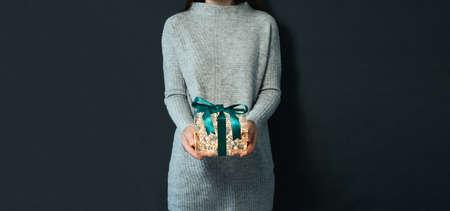 Christmas,New Year concept,luminous gift box,hands