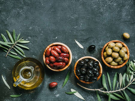 Set of different types olives and olive oil
