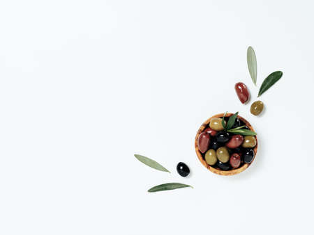 Olives with leaves on white, copy space, top view