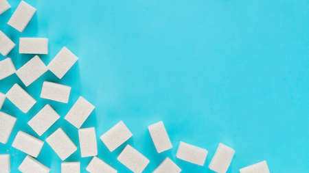 background of white sugar cubes with copy space