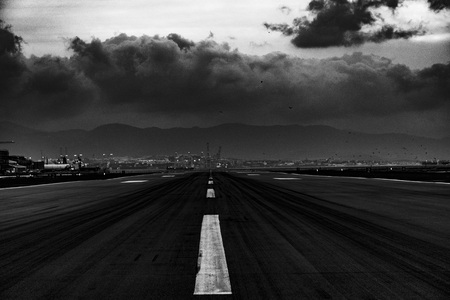 storm arriving on the landing strip in Gibraltar with a striking black and white