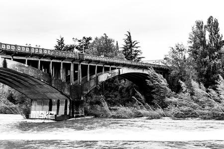 victory bridge in Bassano, Italy. taken in black and white from the Brenta river Archivio Fotografico