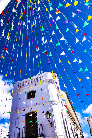 small flags around the square, from below. holiday and happines