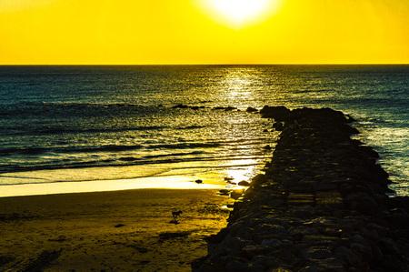 sunset over the Ocean in Cadiz in Spain, with a splendid golden light