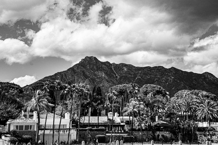 beautiful black and white panorama of the mountains behind Puerto Banus in Spain