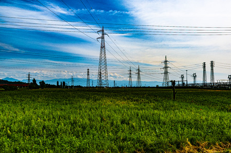 high voltage pylons as if they were a modern forest of metal cables and energy Imagens