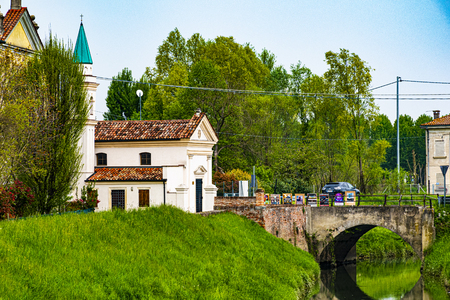 old church with brick bridge in a small village near Padua.