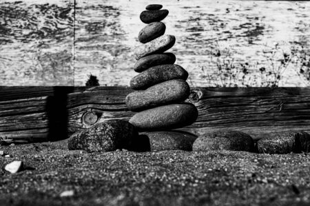 pebbles stacked to form a splendid pyramid on the beach of Marbella create an opportunity to meditate and relax with yoga