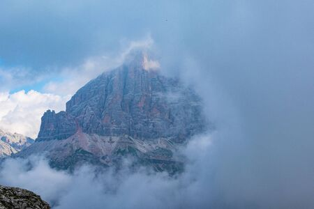 beautiful clouds on the peaks of the Dolomites   near Cortina on a strange summer day Banque d'images