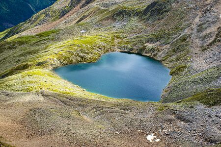 beautiful lake in the shape of heart love on the top of the Gaislachkogel mountain theater of many films, ski slopes and downhill