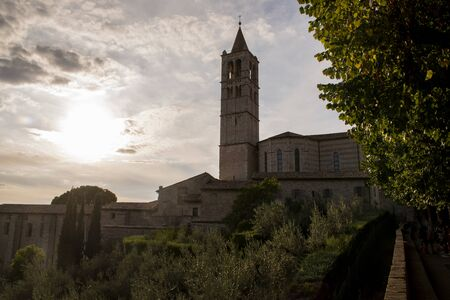 St. Chiara church in Assisi, Umbria, Italy at dusk with clouds