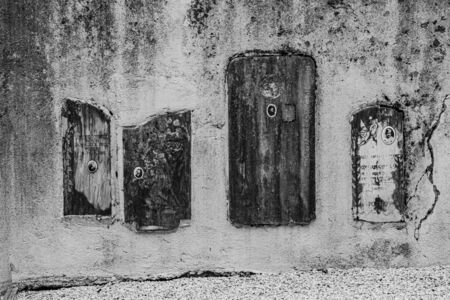 Vintage 19th century old marble tombstones abandoned and set in the perpetual memory wall