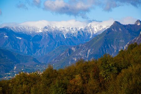 the first snow in the pre-Alps on the path to Monte Pau in Cogollo del Cengio in the province of Vicenza, Veneto, Italy.
