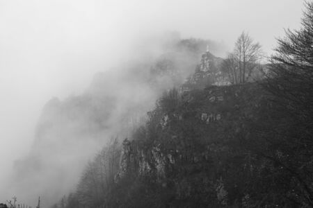 the November fog hides the panorama and the mountains on the path to Monte Pau in Cogollo del Cengio in the province of Vicenza, Veneto, Italy.