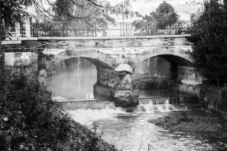 black and white image of the stone and brick bridge in Sovizzo small town on the hills of Vicenza, Veneto, Italy.