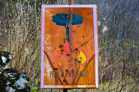 old fire signal corroded by time and mans injury Stockfoto