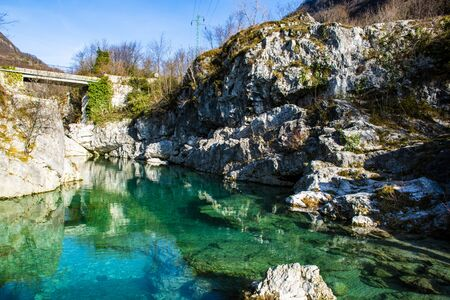 limpid mountain stream flows cold among millennial rocks of the Vicenza Alps carved out by time in Contra Pria near Arsiero, in the province of Vicenza in the Veneto Italy