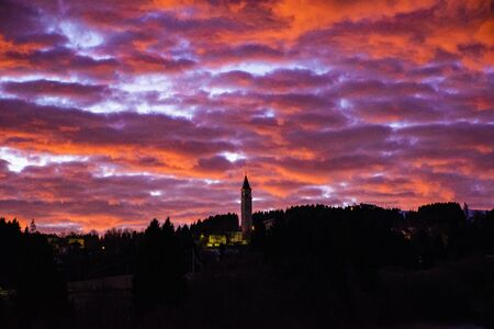 beautiful red clouds illuminated by the winter sunrise in Asiago, Vicenza, Veneto, Italy.