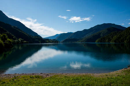 image of Lake Ledro in the early morning in the province of Trento, Italy