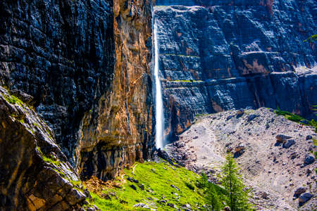 beautiful and majestic waterfall of Val Travenanzes in the Dolomites of Cortina D'ampezzo in Belluno, Veneto, Italy
