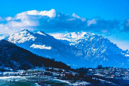 snowy alpine peaks with clouds and blue sky, in Vicenza, Italy Zdjęcie Seryjne