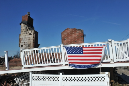 NEW YORK, NY - NOVEMBER 09: An American flag flies from the burned house in a damaged area November 9, 2012 in the Breezy Point part of Far Rockaway in the Queens borough of NY.