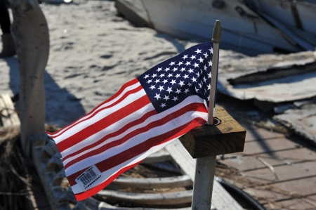 NEW YORK, NY - NOVEMBER 09: An American flag flies from the burned house in a damaged area November 9, 2012 in the Breezy Point part of Far Rockaway in the Queens borough of NY. Stock Photo - 16558977