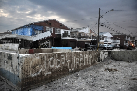 outage: QUEENS, NY - NOVEMBER 11: Damaged houses without power at night in the Rockaway beach - Bel Harbor area due to impact from Hurricane Sandy in Queens, New York, U.S., on November 11, 2012.