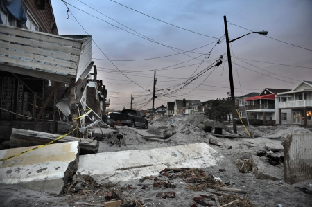 catastrophic: QUEENS, NY - NOVEMBER 11: Damaged houses without power at night in the Rockaway beach - Bel Harbor area due to impact from Hurricane Sandy in Queens, New York, U.S., on November 11, 2012.