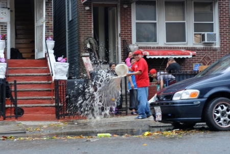 BROOKLYN, NY - OCTOBER 29: People pumping water out of building basement in the Sheapsheadbay neighborhood due to flooding from Hurricane Sandy in Brooklyn, New York, U.S., on Tuesday, October 30, 2012.  