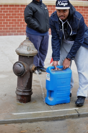 BROOKLYN, NY - NOVEMBER 01: People at the Seagate neighborhood feeling up water from fire hydrant  due to impact from Hurricane Sandy in Brooklyn, New York, U.S., on Thursday, November 01, 2012.   Stock Photo - 16558975