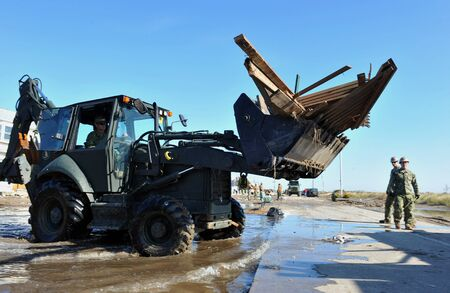 engineer's: NEW YORK, NY - NOVEMBER 09  U S  Marines from the 8th Engineer Support Battallon out of Camp Lejeune, North Carolina, move a debris and parts of destroyed houses in the Breezy Point part of Far Rockaway on November 9, 2012 in the Queens borough of NY