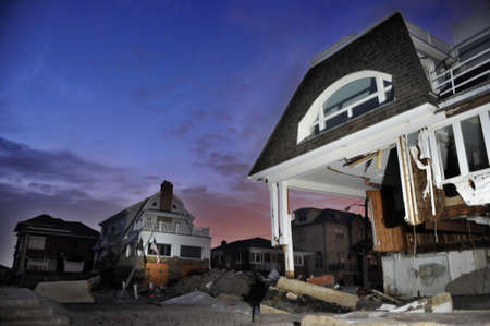 hurricane sandy: QUEENS, NY - NOVEMBER 11: Damaged houses without power at night in the Rockaway beach - Bel Harbor area due to impact from Hurricane Sandy in Queens, New York, U.S., on November 11, 2012.